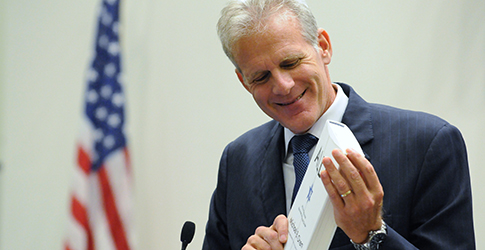 Michael Oren holding his book